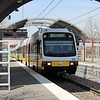 DART (Dallas Area Rapid Transit) Kinki Sharyo Super Light Rail Vehicle (SLRV) No. 104 departing Trinity Mills Interchange Station