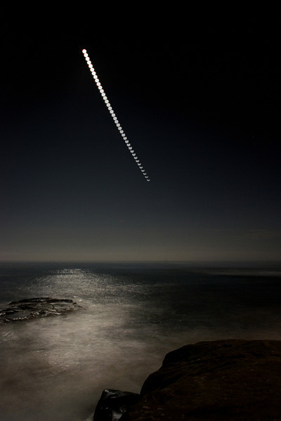 2011-12 Windansea  Tracking the moon during the 12/10/11 Lunar Eclipse.  This is layered from multiple images taken every 2.5 minutes, including a longer exposure that lit up the ocean and rocks in the foreground.