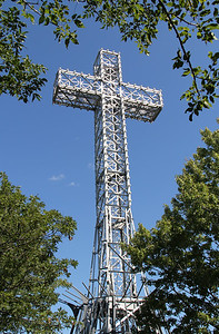 Giant Metal White Cross Against Blue Sky