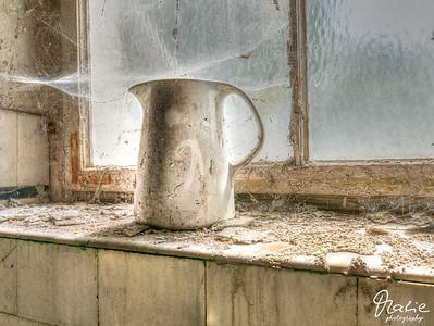forgotten cobwebby old jug