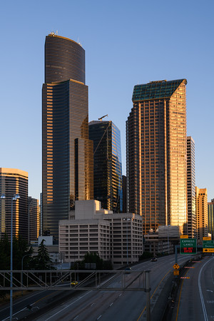 Columbia Tower and Seattle Municipal Tower in morning light above I-5