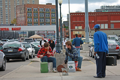 Musicians drumming with buckets(!) at Detroit's Eastern Market.
