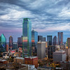 Stormclouds Over Dallas, Dallas, Texas (March 2018)<br /> <br /> Landscape and cityscape photography has an odd risk/reward dynamic to it.    In nice weather, you might have an enjoyable experience, but are unlikely to get a dramatic shot.  In nasty weather, most of the time you are destined for failure.  Grey, misty, nastiness  doesn't lend itself to great pictures.  You are likely to get rained on, have a miserable time, and come home with nothing.  But every now and then, when conditions look terrible, things change slightly, or the skies open up just a bit, and you get absolutely GREAT conditions.   So you have to brave the terrible conditions so you are around for that 1% chance that you get the dramatic light.<br /> <br /> Such was the case here.  We planned to go to downtown Dallas and photograph from Reunion Tower.  The sky was grey and uninteresting, and there were storms in the area.  We went anyway.  We got there and were told that we could not go out on the observation desk because of the bad conditions.  We went up anyway.  When we got up to the top, conditions had improved a bit they let us on the observation desk.  We were treated to this sky and the nice reflections on the buildings.  <br /> <br /> Sometimes things work out.  Trudge on!