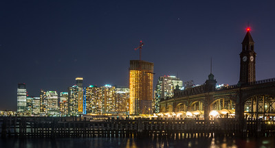 Downtown Jersey City Skyline & Hoboken Terminal at night