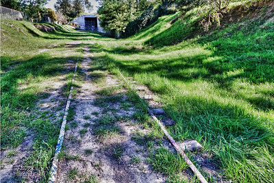 Abandoned tracks near Overland Ave. lead to a tunnel under the 10 Freeway. This may someday be the route of a new light rail system.