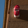 """This form of """"Street Art"""" is down to a guy (I think) called the Trainer Angel.  Clever idea.....and so simple....<br /> Not sure where the other shoe is though!"""