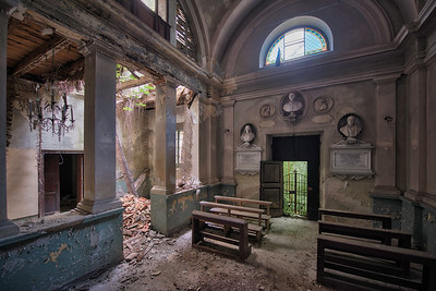Asylum Chapel - The old chapel of an abandoned mental institution. Crystal chandeliers and large stone busts still preserved.