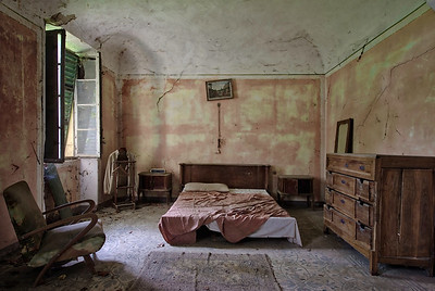 Recluse - Bedroom in an abandoned house.  A very plain room in this big abandoned house. which is a big contrast to the decorated hallway right next to it