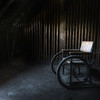 Secluded - Vintage wheelchair inside an abandoned carehome