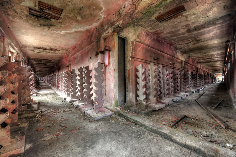 """Red Forest - I have never witnessed such a long corridor as in this abandoned factory. The red """"trees"""" were probably used to hold or dry someting extremely long."""