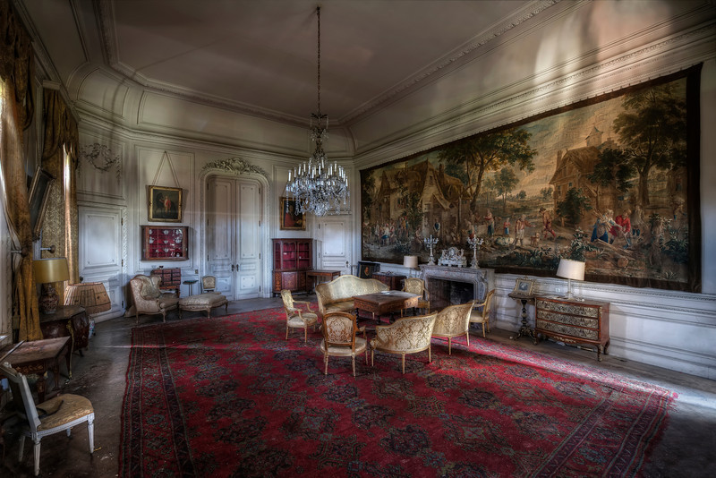 Awe - While the rooms on the upper floors of this abandoned castle are already showing signs of heavy decay this room is in mint condition. incredible that the valuables aren't stored in a safe environment. The paintings, furniture and wall tapestries have been badly damaged by mold and water.