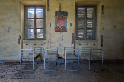 It's a hard knock life - children's beds in an abandoned boarding school