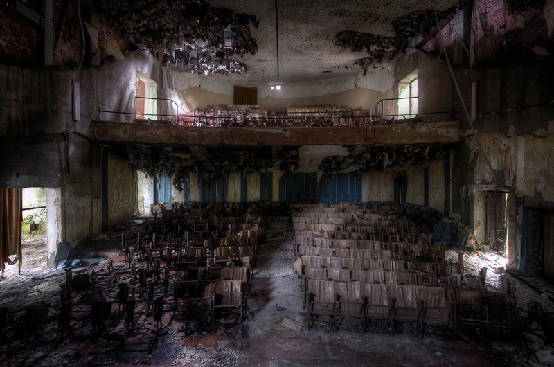On with the show ! - abandoned theater with maximum decay. Almost crapped my pants standing on the rotten stage full of holes expecting to crash through the floor and suffer a 10 feet drop.