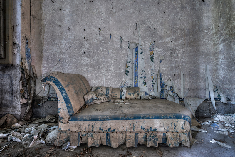 Relax - Abandoned Chaise Longue in a crumbling villa. This beautiful old villa is on the verge of collapse while a lot of furniture is left to rot.