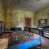 Whatever you do, don't fall asleep. - Colorful hotel room left to decay