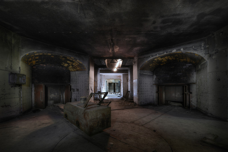 The Crematorium - Basement of an abandoned crematorium. At the right and left are the main incinerators. In the fron the big cart to push the bodies into the fire. Extremely difficult shot because this basement is almost pitch black. Very long shutter times to capture the light.