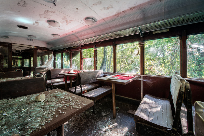 Dining train - This is a weird situation. A train dining carriage way high up a mountain slope, parked in the woods. No train tracks in the near surroundings.... It looks like it was just dropped out of the sky.