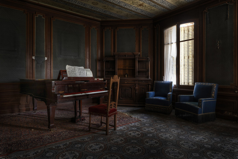 The piano room - It was very strange to walk into this room. The whole mansion has been trashed except for this lovely piano room. Unfortunately within weeks after our visit some people decided to wreck the piano.