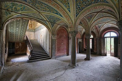 Arched - Entry and staircase in an abandoned villa in the woods