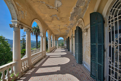 Balcony - This is a villa with a view. This is just the lower balcony, there also is one above. Both have a staggering view on the city below. This villa is in a pretty good shape and someone can move in right away.