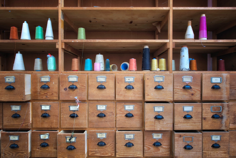Fashionworks - Colorful bobbins left behind in a former fashion factory