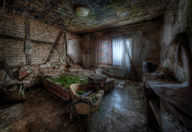 No Vacancy - Re-edit of this shot of an abandoned hotel room. A fire ravaged a large part of the hotel and this room was right beside the fire. Its moss bed and frozen floor make a great photo subject. I did have a lot of problems shooting and processing it. The room is not that big and even though i have a pretty wide lens (14mm on FF) i needed to create a portrait panorama to show the entire space.
