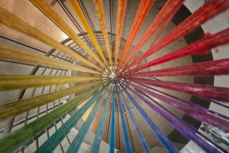 Color bomb - This is actually not abandoned but the middle of a modern spiral staircase. The colors are strings that hang from the top to the bottom