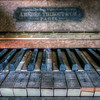 Soundless - Old dusty piano keys inside an abandoned hotel