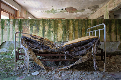 Hallucination - Rotting bed left behind in a former sanatorium in the mountains.