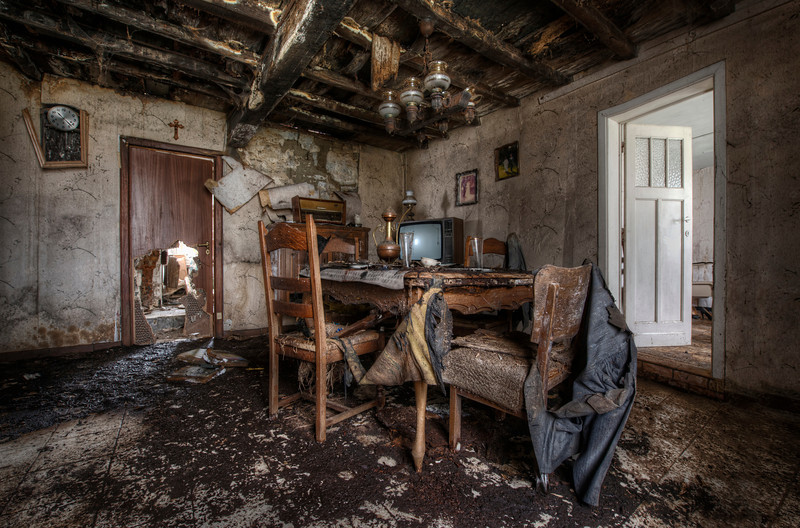 The Last Supper - Small abandoned farmhouse. The ceiling has suffered so much water damage that the big wooden beams can collapse at any minute. Shot in 2012