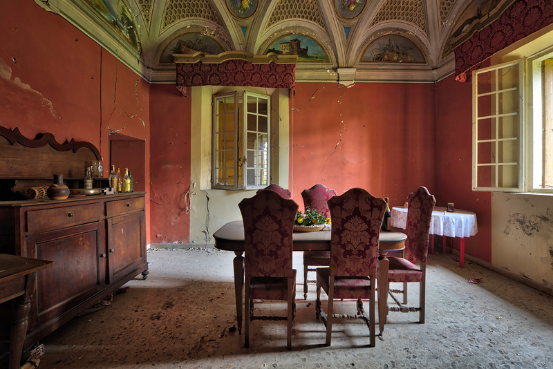 The Red Room - One of many furnished room in an abandoned castle. Unfortunately due to a massive earthquake this place was turned into a time capsule. Part of the castle collapsed and the other rooms are in a very unstable condition. The place became so dangerous that not even the owner was allowed access.
