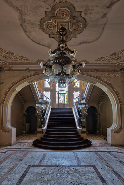 Magnificum - The first thing you see when stepping inside this abandoned casino is this magnificent staircase. A truly great piece of architecture. The stained glass and crystal chandeliers still present.