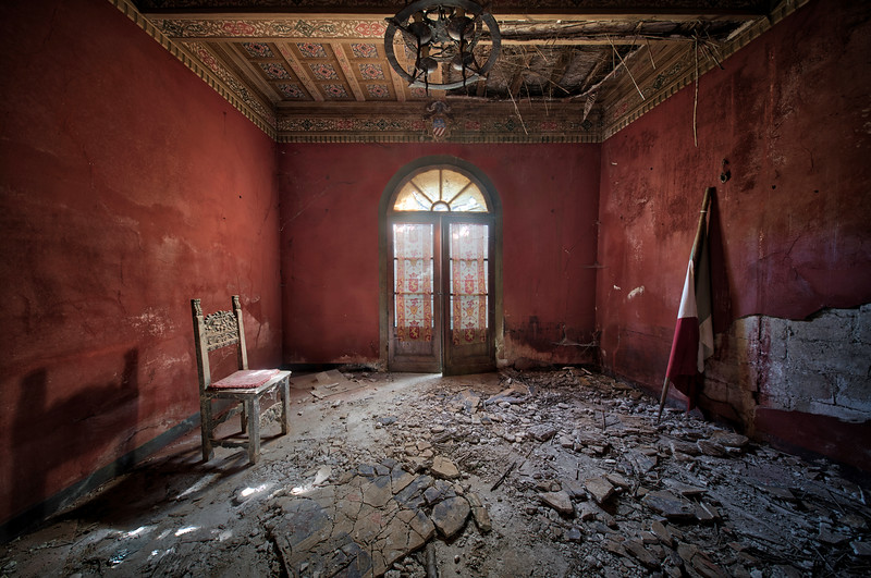 Partigiano - I just love the simplicity of this room with its red walls. It was probably the entry hall to this abandoned villa.