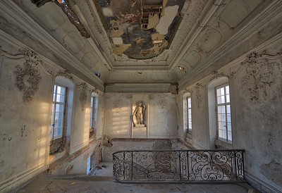 Guardian - Morning light shines on an old statue which guards the staircase in this crumbling castle