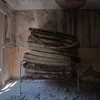 Swiss Sense - Stack of mouldy mattresses in an old decaying hospital.