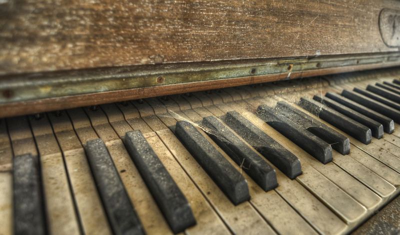 The Day the Music Died - Dusty piano inside an abandoned hotel