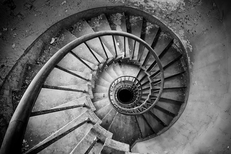 The downward Spiral - Staircase inside an abandoned monastery