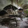 Lost Hearses - Vintage horse drawn hearses hidden inside an abandoned monastery.