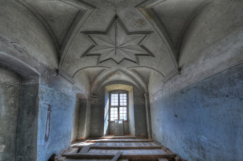 Illuminati - massive abandoned place full of rooms which have all kinds of crazy ceiling decorations.