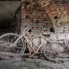Bicycle race lost - decayed bicycle left behind in the cellar of an abandoned villa.