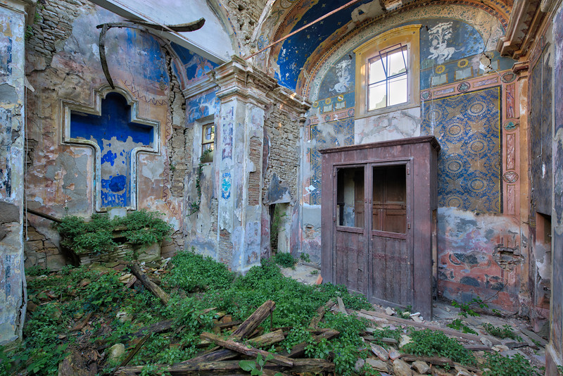Blue Cross - Colourful abandoned church way beyond repair
