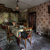 Waiting for dinner - The dining room in a very unstable decayed farmhouse. Floors are collapsing and even climbing the staircase has become an adventure.