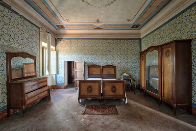 Gone but not forgotten - Furniture left behind in this abandoned villa.