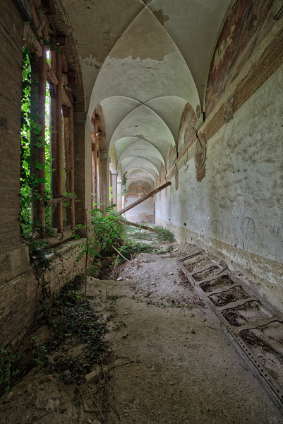 The Aisle - One of the corridors in a former monastery. The place has been abandoned for some time now. Vintage hearses and old coffins just left behind.