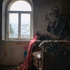 Granny - Amazing piece of graffiti artwork combined with left behind items in an abandoned villa. Very hard shot to make. Photographing from a poor lit room with incoming bright daylight was a really nice challenge.