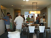 DB2 and OUT for Sustainability mingle in the kitchen of the model unit