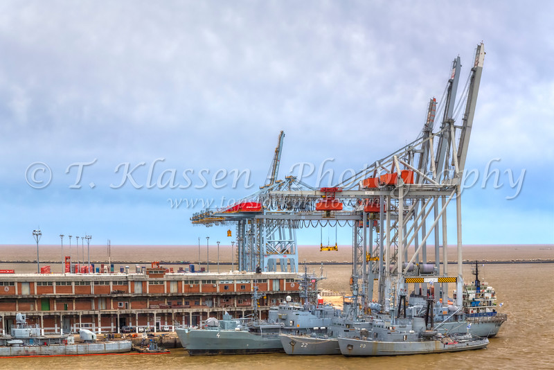 Container loading cranes and Navy ships at the port of Montevideo, Uruguay, South America.