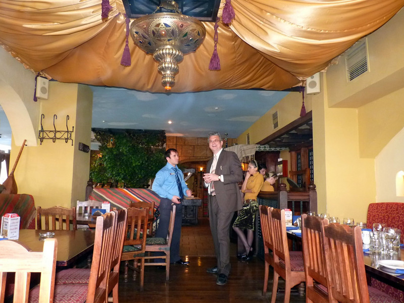 Rustem speaks with the restaurant manager while awaiting our guests for his 50th birthday.