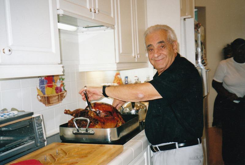Dad carving turkey. Florida. Thanksgiving (2004)