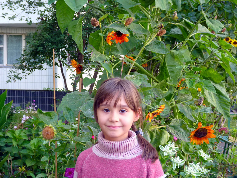 A neighbor girl in the garden in front of our apartment building. (2010)